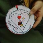 Caravaggio Simbolo pellegrini rossi